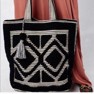 Anthropologie large diamond patterned carpet bag